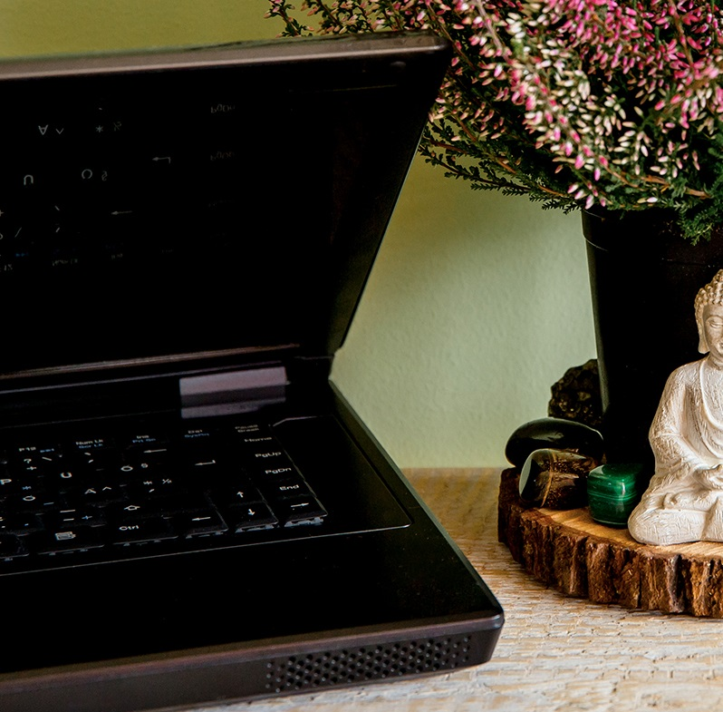 crystals placed beside a computer